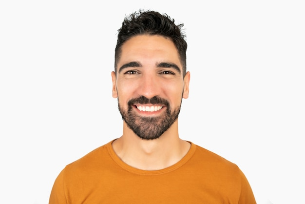 Portrait of young happy man smiling against white space