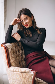 Portrait of young happy woman in studio