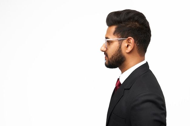 Portrait of young indian business man on white isolated background.