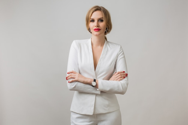 Portrait of young lady in white suit confident