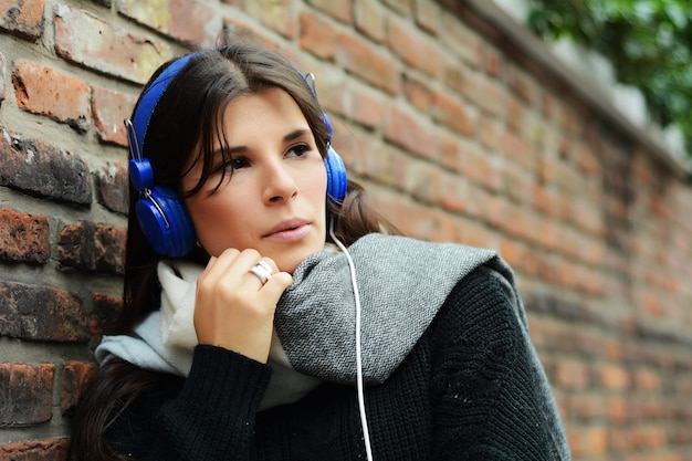 Portrait of young latin woman with blue headphones