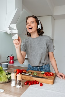 Portrait of a young laughing woman with headphones