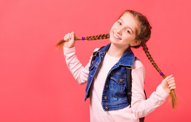 Portrait of young little girl with two braides