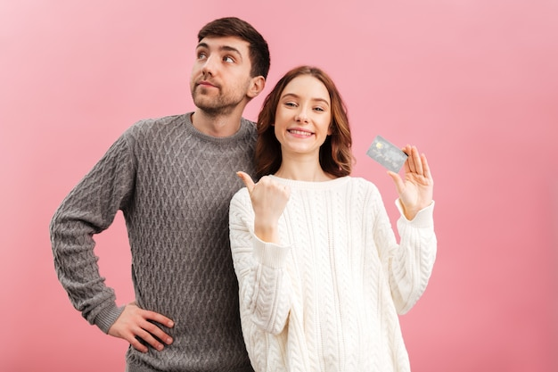 Portrait of a young loving couple dressed in sweaters