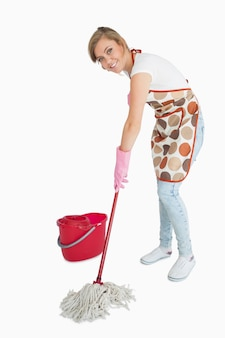Portrait of young maid mopping floor