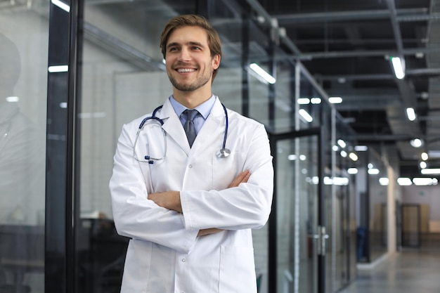 Portrait of young male doctor with stethoscope, close up