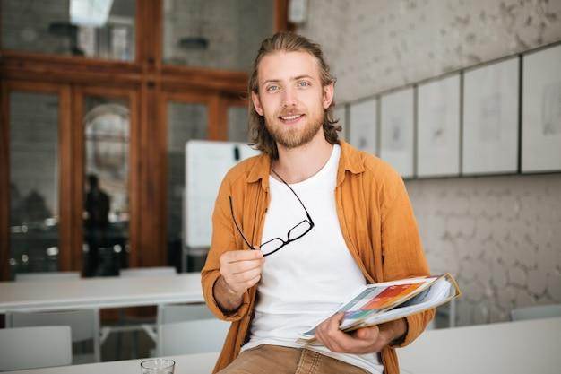 Portrait young male teacher in class