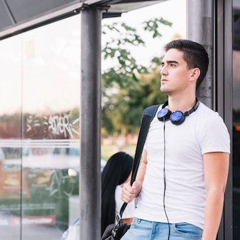 Portrait of a young man at bus station