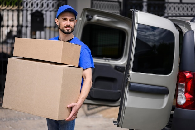 Portrait of young man carrying delivery