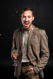 Portrait of young man celebrating new years