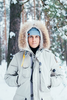 Portrait of young man in cold deep winter coat