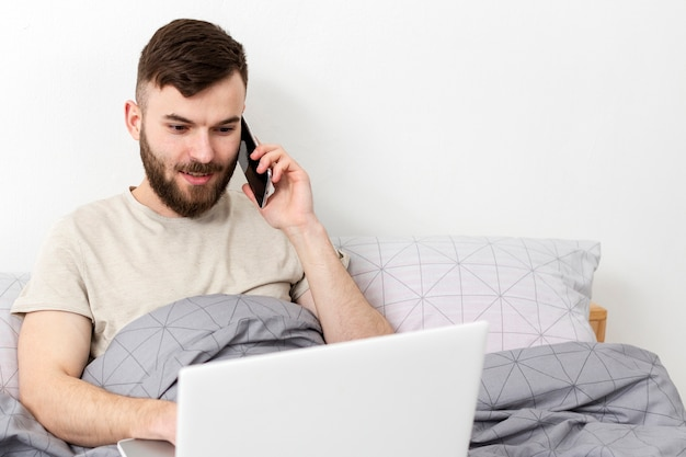 Portrait of young man enjoying remote work