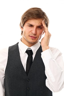 Portrait of young man having strong migraine