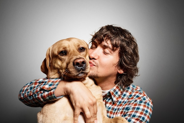 Portrait of young man and his cute dog