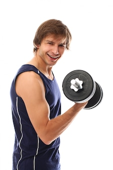 Portrait young man holding a dumbbell