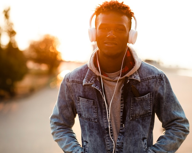 Portrait young man listening music