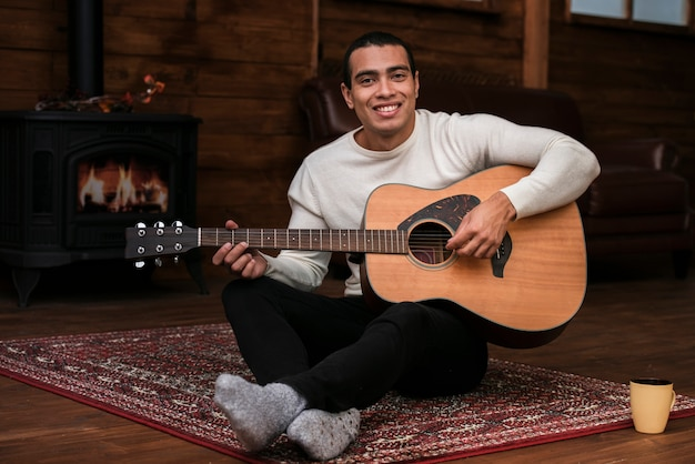 Portrait of young man playing guitar