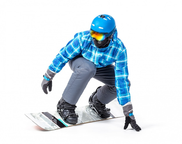 Portrait of young man in sportswear with snowboard isolated on a white surface,