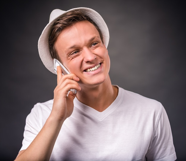 Portrait of young man use the phone