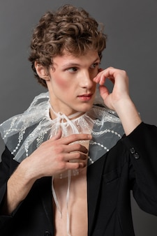 Portrait young man wearing make up and stylish clothes
