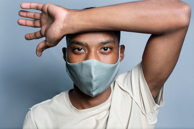 Portrait young man wearing mask