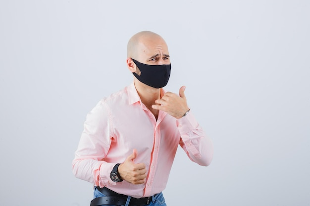 Portrait of young man wearing a protective mask