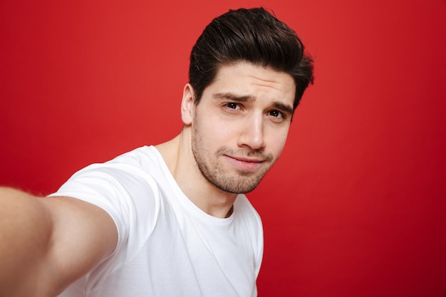 Portrait of a young man in white t-shirt