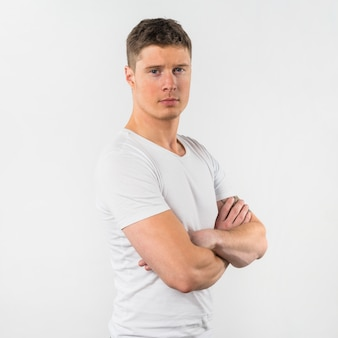 Portrait of a young man with arms crossed isolated on white background