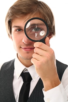 Portrait of young man with magnifying