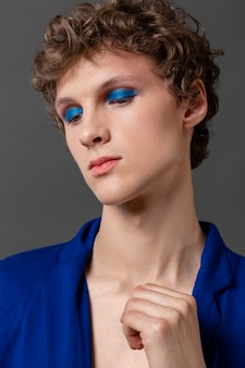 Portrait young man with make up posing