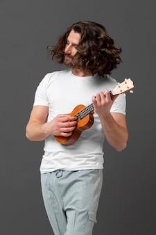 Portrait young man with ukulele