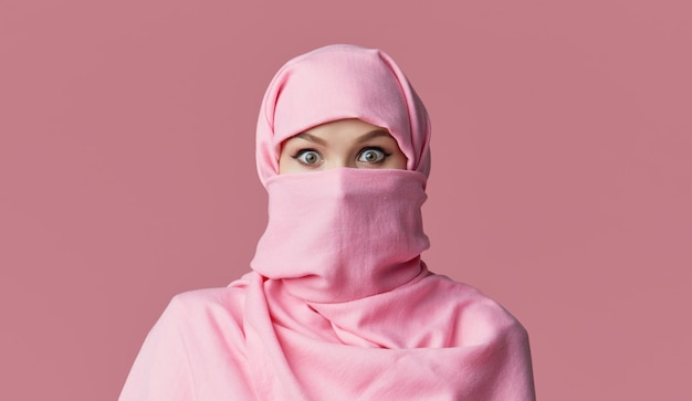 Portrait of young muslim arabian woman wearing colorful hijab. points finger to side.