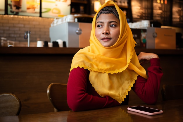 Portrait of  young muslim woman in coffee shop