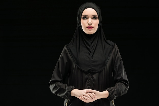 Portrait of young muslim woman in traditional clothes