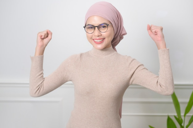 Portrait of  young muslim woman wearing glasses