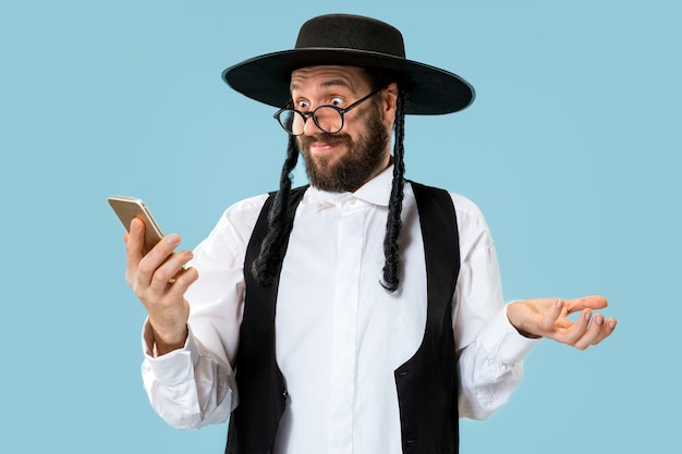 Portrait of a young orthodox jewish man during festival purim.