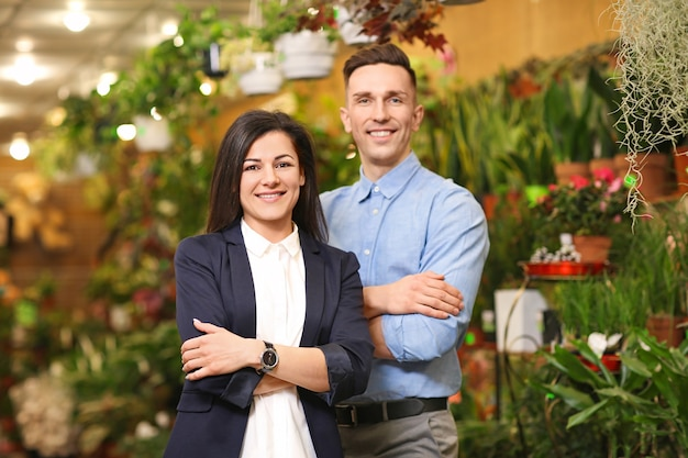 Portrait of young people in greenhouse. small business owners