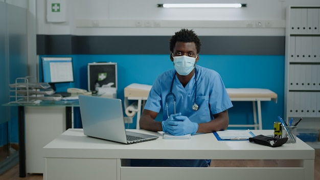 Portrait of young person working as nurse in cabinet