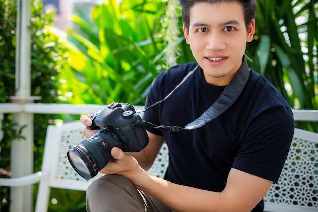 Portrait of young photographer man