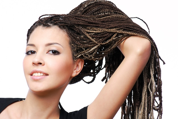 Portrait of young pretty girl showing the  dreadlocks  on