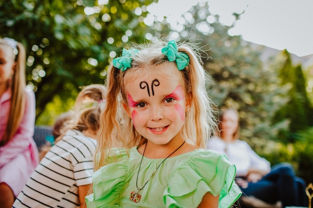 Portrait of young pretty girl with face painting
