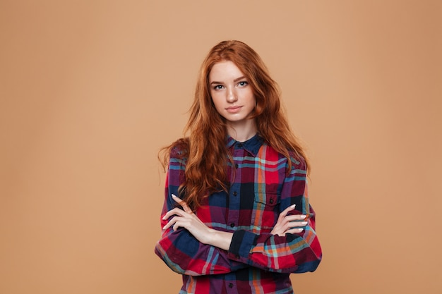 Portrait of a young pretty redhead girl