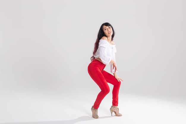 Portrait of a young salsa dancer with heels
