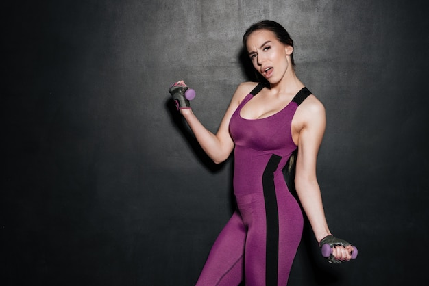 Portrait of a young sexy fitness woman doing sport exercises