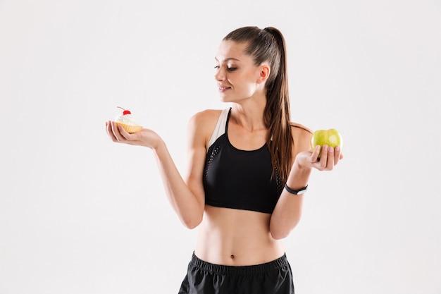 Portrait of a young slim sportswoman