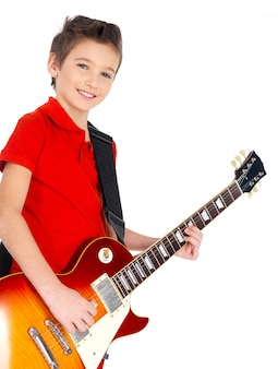Portrait of young smiling boy with a electric guitar -