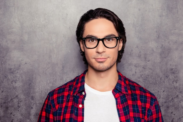 Portrait of young smiling handsome hispanic man in glasses