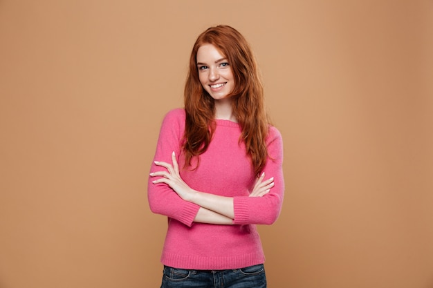 Portrait of a young smiling redhead girl