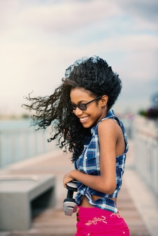 Portrait of young smiling woman on windy day