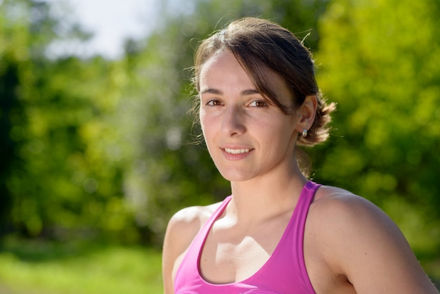 Portrait of young sporty woman in the countryside